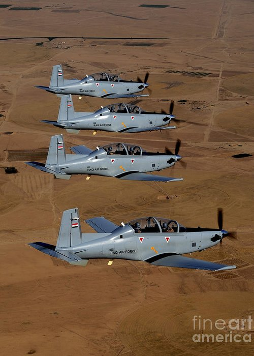 Trainer Greeting Card featuring the photograph A Formation Of Iraqi Air Force T-6 by Stocktrek Images
