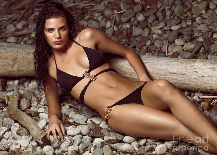 Bikini Greeting Card featuring the photograph Beautiful Young Woman In Black Bikini On A Pebble Beach by Oleksiy Maksymenko