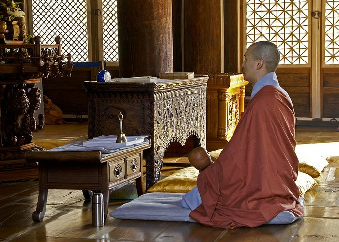 Asia Greeting Card featuring the photograph Buddhist Monk In Prayer by Michele Burgess
