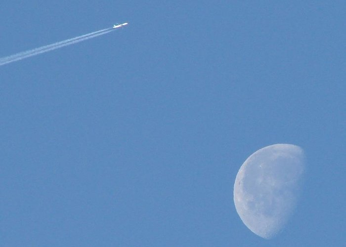Moon Greeting Card featuring the photograph Flying Over The Moon by Liz Vernand