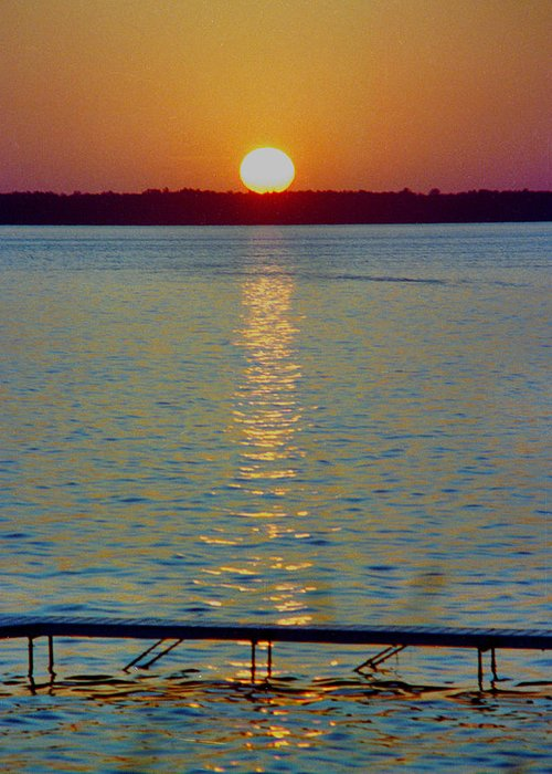 Sunset Greeting Card featuring the photograph Quite Pier Sunset by Randy Oberg