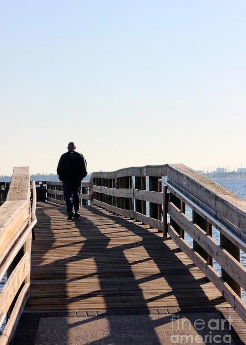 Man Greeting Card featuring the photograph Solitary Man Walks by Mesa Teresita