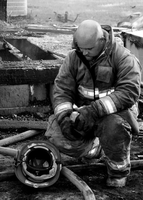 Firefighter Greeting Card featuring the photograph The Praying Firefighter Black And White by Dana Blalock