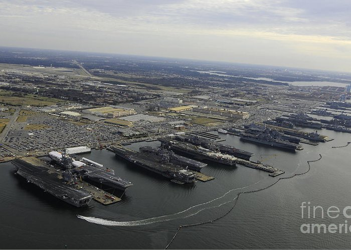 Military Greeting Card featuring the photograph Aircraft Carriers In Port At Naval by Stocktrek Images