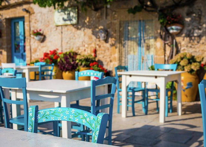 Blue Greeting Card featuring the photograph Tables In A Traditional Italian Restaurant In Sicily, Italy by Paolo Modena