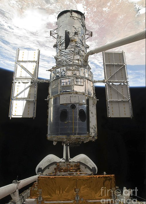 Releasing Greeting Card featuring the photograph The Hubble Space Telescope Is Released by Stocktrek Images