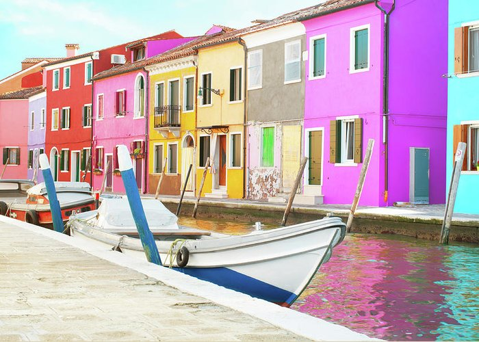 Burano; Italy; Travel; Boat; Colorful; Painted Houses; Tourism; Italian; Europe; Venetian Lagoon; House; Sky; Architecture; Famous; Building; Street; Landmark; Italia; Venezia; Village; Tourism; Island; Summer; Venetian; Mediterranean; Old; Historic; Outdoor; Lagoon; Italian Architecture; Clouds; Bridge; Doors; Windows; Water Greeting Card featuring the photograph Burano Italy by Peter Horvath