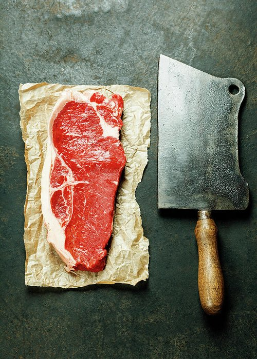 Meat Greeting Card featuring the photograph Vintage Cleaver And Raw Beef Steak by Natalia Klenova