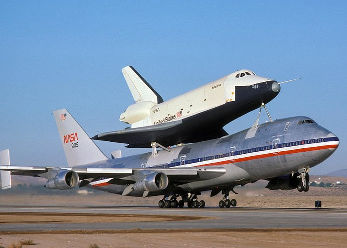 Space Greeting Card featuring the photograph 747 Takes Off With Space Shuttle Enterprise For Alt-4 by Brian Lockett