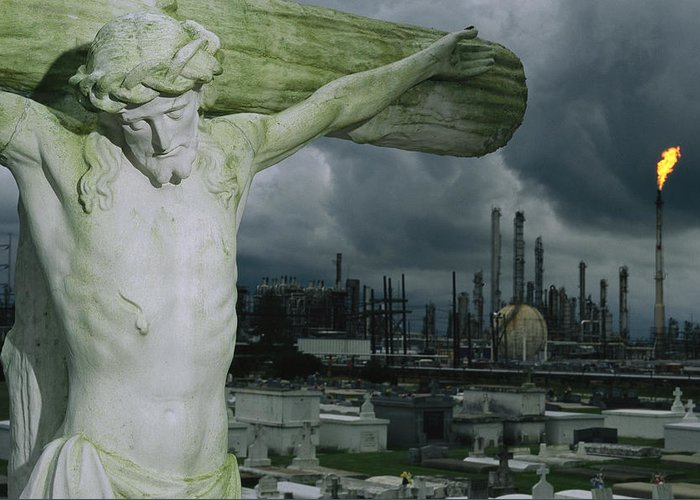 North America Greeting Card featuring the photograph A Crucifixion Statue In A Cemetery by Joel Sartore