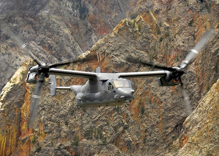 Cv-22 Greeting Card featuring the photograph A Cv-22 Osprey Flies Over The Canyons by Stocktrek Images