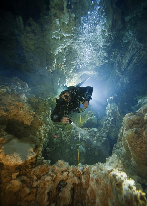 Underwater Greeting Card featuring the photograph A Diver Ascends A Deep Shaft In Dans by Wes C. Skiles