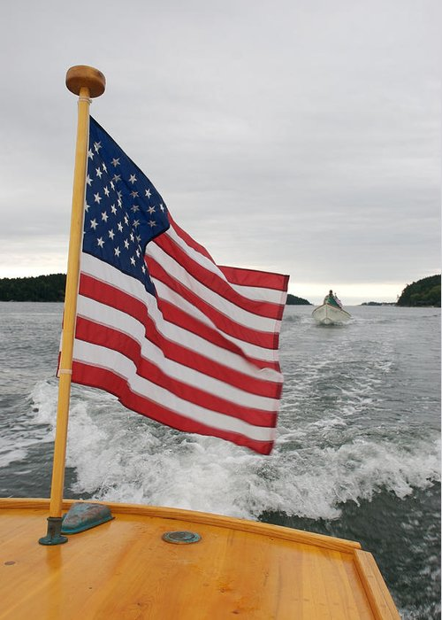 Nobody Greeting Card featuring the photograph A Flag Waves On The Stern Of A Maine by Heather Perry