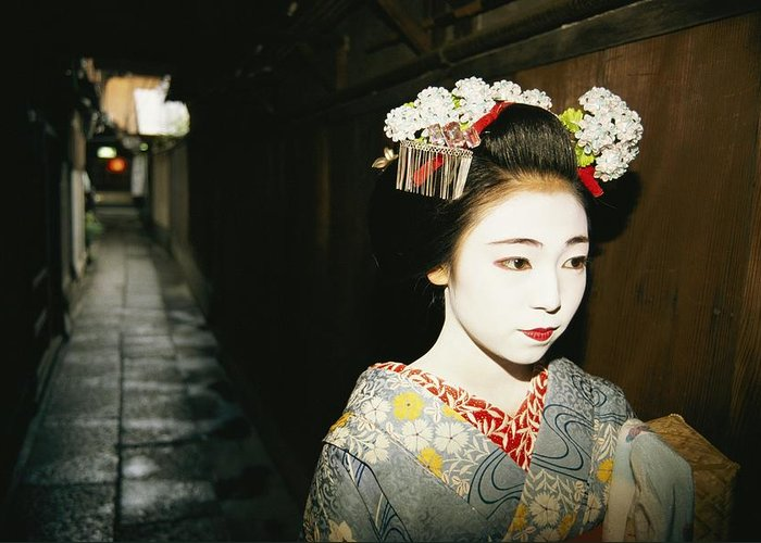 Asia Greeting Card featuring the photograph A Geisha In Traditional Costume Walks by Paul Chesley