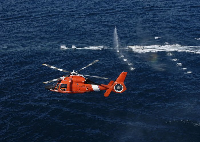 Hitron Greeting Card featuring the photograph A Helicopter Crew Trains Off The Coast by Stocktrek Images