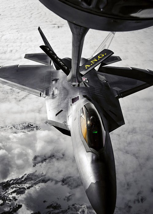 Aerial Greeting Card featuring the photograph A Kc-135 Stratotanker Refuels A F-22 by Stocktrek Images