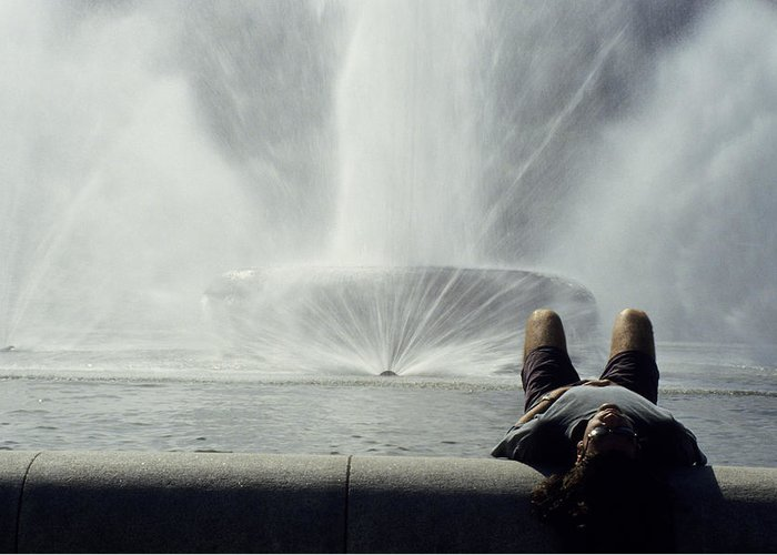 Pittsburgh Greeting Card featuring the photograph A Man Relaxes At A Fountain by Stacy Gold