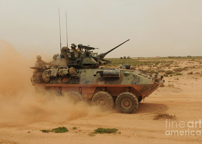 Dust Greeting Card featuring the photograph A Marine Corps Light Armored Vehicle by Stocktrek Images