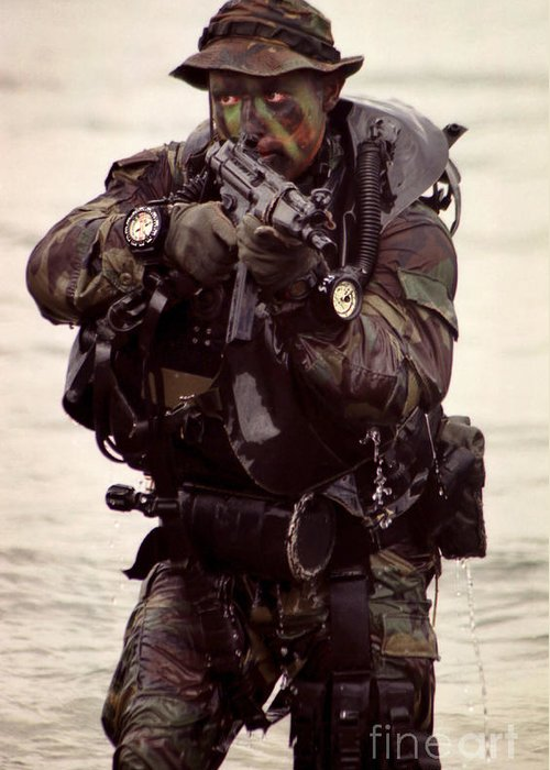 Military Greeting Card featuring the photograph A Navy Seal Exits The Water Armed by Michael Wood