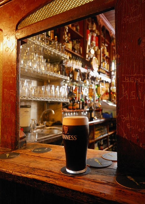 Day Greeting Card featuring the photograph A Pint Of Dark Beer Sits In A Pub by Jim Richardson