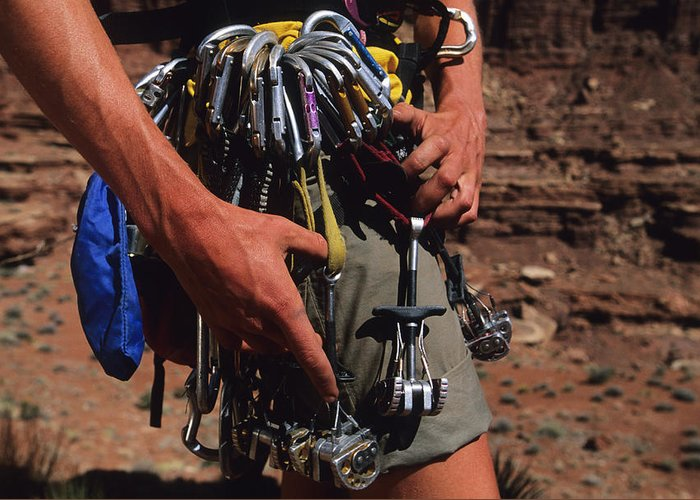 One Person Greeting Card featuring the photograph A Rock Climber Check Her Gear by Bill Hatcher