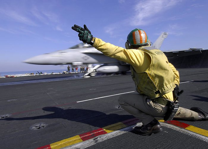 Operation Enduring Freedom Greeting Card featuring the photograph A Shooter Signals The Launch Of An by Stocktrek Images