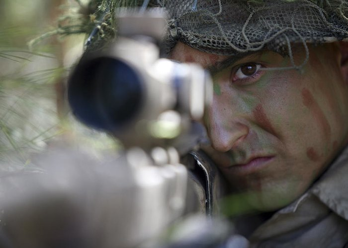 Us Marines Greeting Card featuring the photograph A Sniper Sights In On A Target by Stocktrek Images