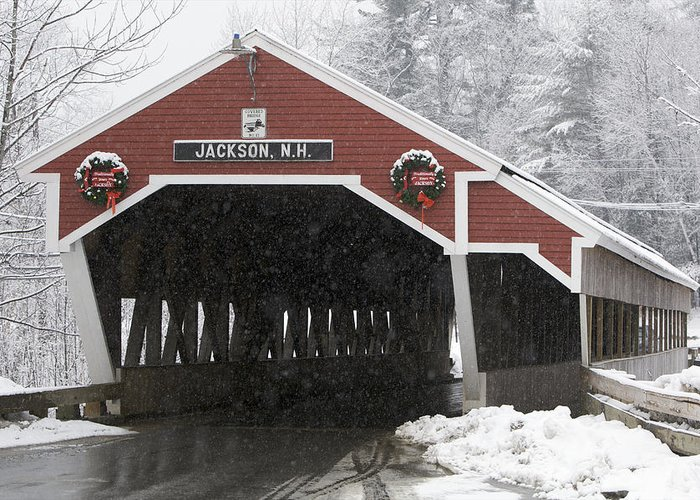 Day Greeting Card featuring the photograph A Traditional Covered Bridge On A Snowy by Tim Laman
