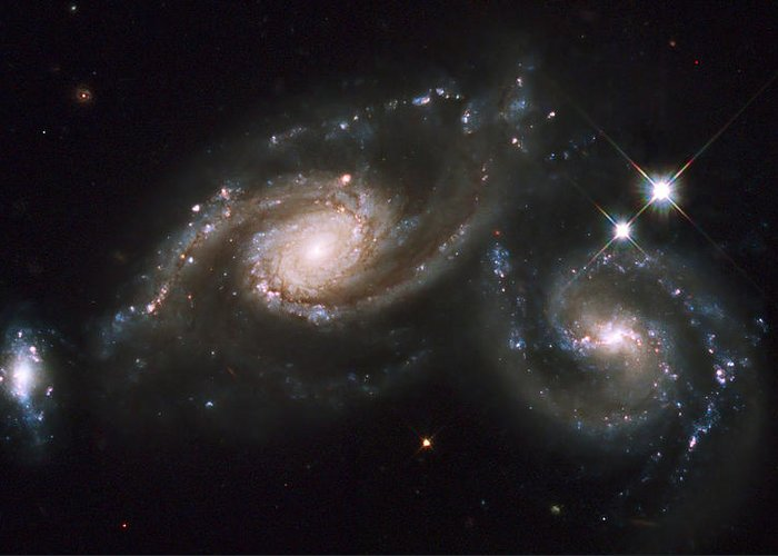 Twinkle Greeting Card featuring the photograph A Triplet Of Galaxies Known As Arp 274 by Stocktrek Images
