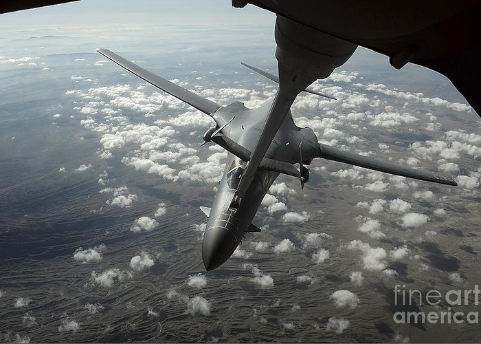 In-flight Greeting Card featuring the photograph A U.s. Air Force Kc-10 Refuels A B-1b by Stocktrek Images