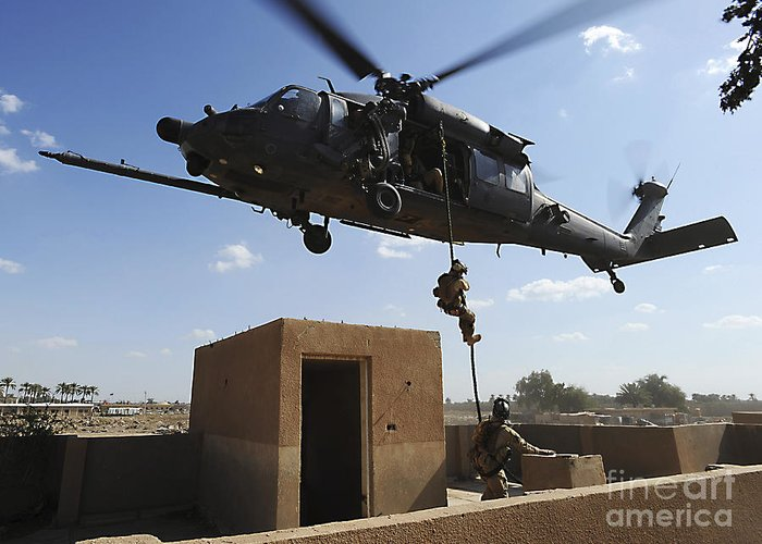 Pararescue Greeting Card featuring the photograph A U.s. Air Force Pararescuemen Fast by Stocktrek Images