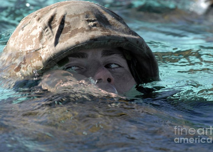 Adults Only Greeting Card featuring the photograph A U.s. Marine Swims Across A Training by Stocktrek Images