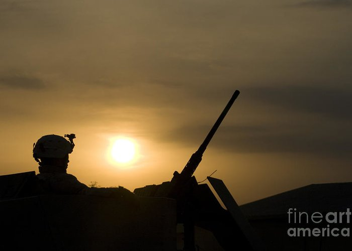 Camp Warhorse Greeting Card featuring the photograph A Us Soldier Mans His .50 Caliber While by Terry Moore