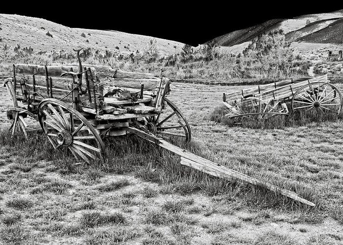 Wagon Greeting Card featuring the photograph Abandoned Wagons Of Bannack Montana Ghost Town by Daniel Hagerman