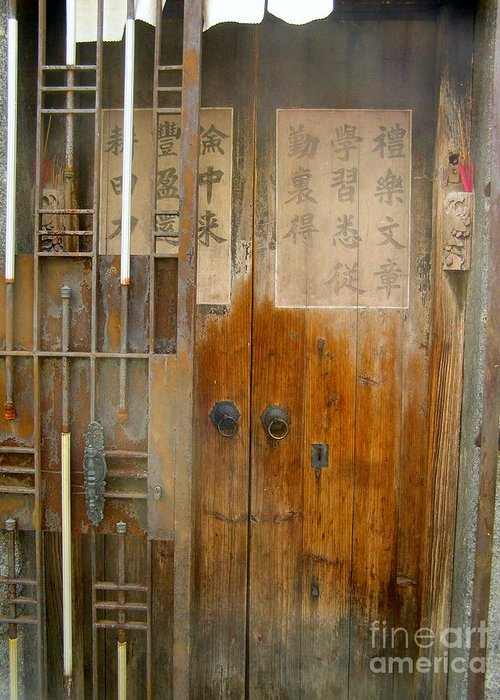 Door Greeting Card featuring the photograph Abandoned Wooden Door With Gate by Kathy Daxon