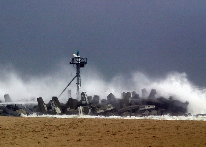 Seascape Greeting Card featuring the photograph Against The Breakers by Mary Haber