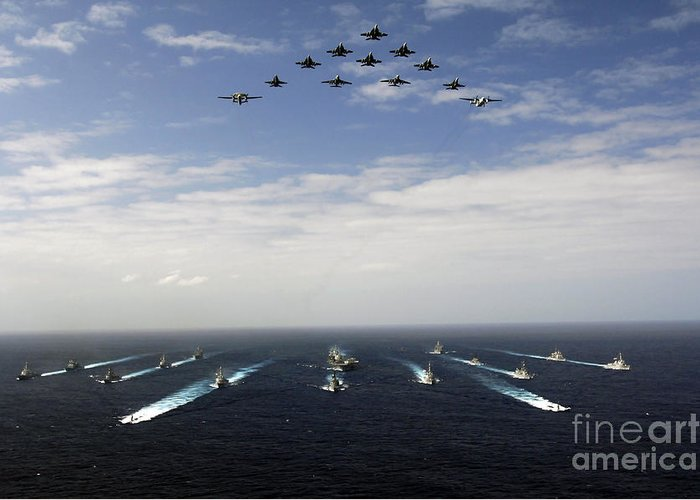 Horizontal Greeting Card featuring the photograph Aircraft Fly Over A Group Of U.s by Stocktrek Images