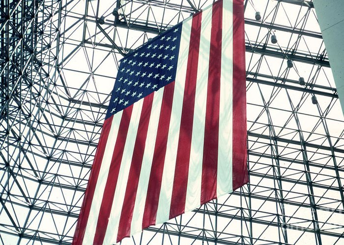Flag Greeting Card featuring the photograph American Flag In Kennedy Library Atrium - 1982 by Thomas Marchessault