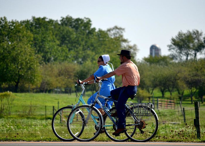 Amish Greeting Card featuring the photograph Amish Bike Ride by Jeffrey Platt