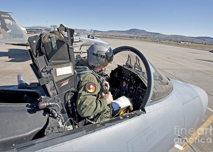 Cockpit Greeting Card featuring the photograph An F-15 Pilot Performs Preflight Checks by HIGH-G Productions