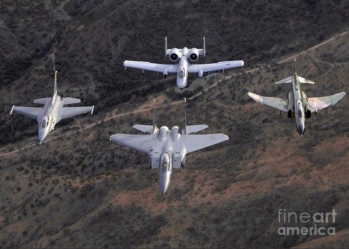 Horizontal Greeting Card featuring the photograph An F-16 Fighting Falcon, F-15 Eagle by Stocktrek Images