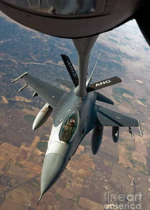 Air-to-air Greeting Card featuring the photograph An F-16 Fighting Falcon Receiving Fuel by Stocktrek Images