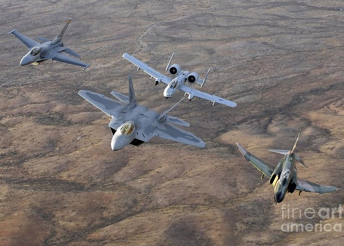 Horizontal Greeting Card featuring the photograph An F-22a Raptor, An F-4 Phantom, An by Stocktrek Images