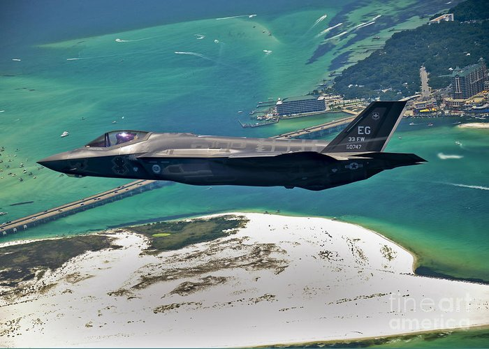 Stealth Greeting Card featuring the photograph An F-35 Lightning II Flies Over Destin by Stocktrek Images