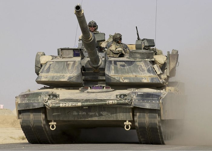 Operation Iraqi Freedom Greeting Card featuring the photograph An M1a1 Abrams Tank Heading by Stocktrek Images