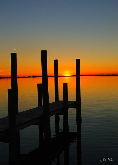 Sunset Greeting Card featuring the photograph At The Pier by Judy Waller