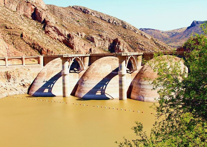 Cooledge Dam On The Apache Reservation In Arizona. Roads A Re Paved But Not Well Maintained. You Can See From The Water Line On The Dam's Dome's That The Water Level Is Down By A Considerable Amount. Greeting Card featuring the photograph Az 2011 Apache Res - Coolidge Dam by Gregory Jeffries