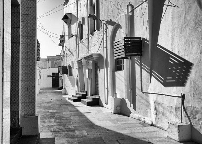 Alley Greeting Card featuring the photograph Backstreet Of Muharraq, Bahrain. by John Grummitt