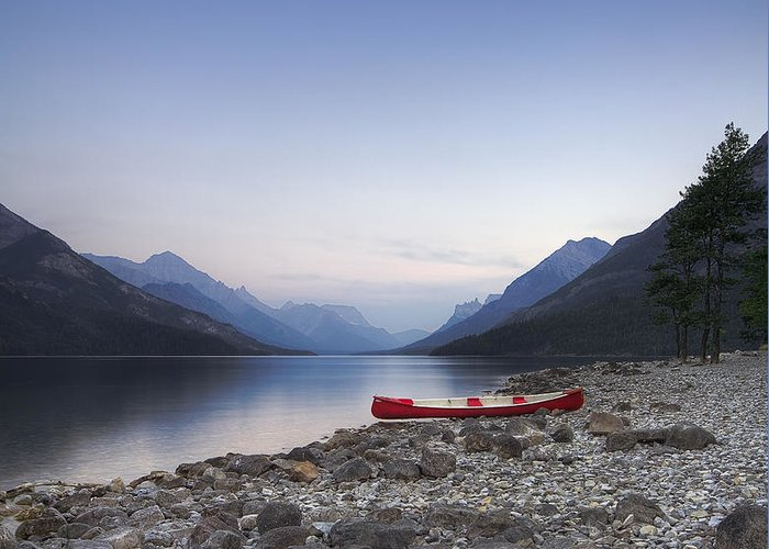 Landscape Greeting Card featuring the photograph Beached Canoe Awaits Nightfall by Royce Howland