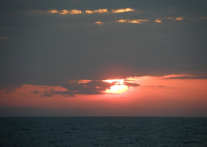Sunset Greeting Card featuring the photograph Between The Gray by Mary Hurst